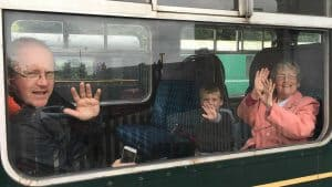 Happy passengers enjoying the train trip