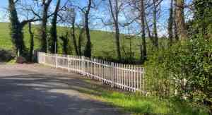 Inch Abbey car park. New white metal picket fencing is shown across the car park.