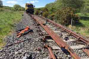 The Bruff road-rail lorry is seen on the track near Inch Abbey. One of the rails in front of the truck has been removed to allow a new rail to be installed.
