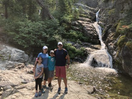 Aster Falls Fam Glacier National Park with kids