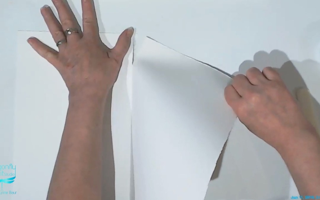 shows hand position for tearing watercolor paper