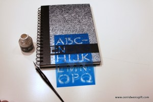Journal with dip pen, lettering template and ink.