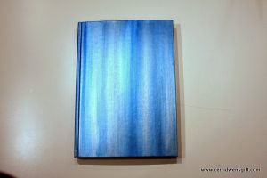 A cover painted in streaks of acrylic colors, blended a little with a brush.
