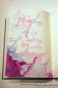 Journal page with colored pencil shading and watercolor.