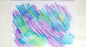 Paper with crayon scribbles.