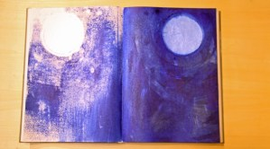 Metallic light blue moon with dark background, with transfer on facing page.