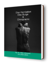 woman touching her back with disc herniation or disc bulge and how chiropractic can help