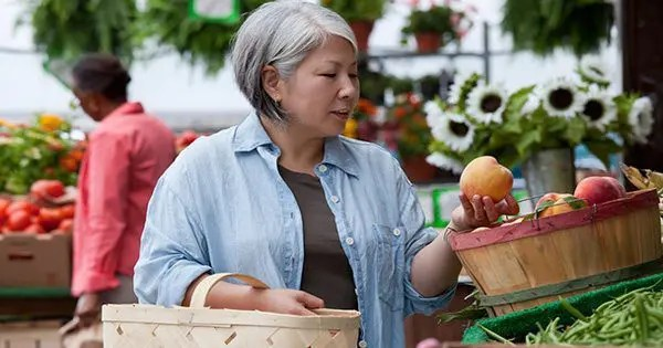 blog picture of elderly woman shopping for fruit