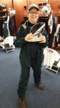 blog picture of chiropractor with award in locker room