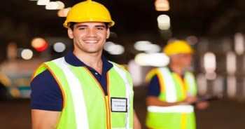 blog picture of construction worker smiling with other workers in background