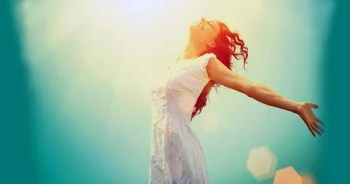blog picture of lady running in the sun with arms wide open smiling