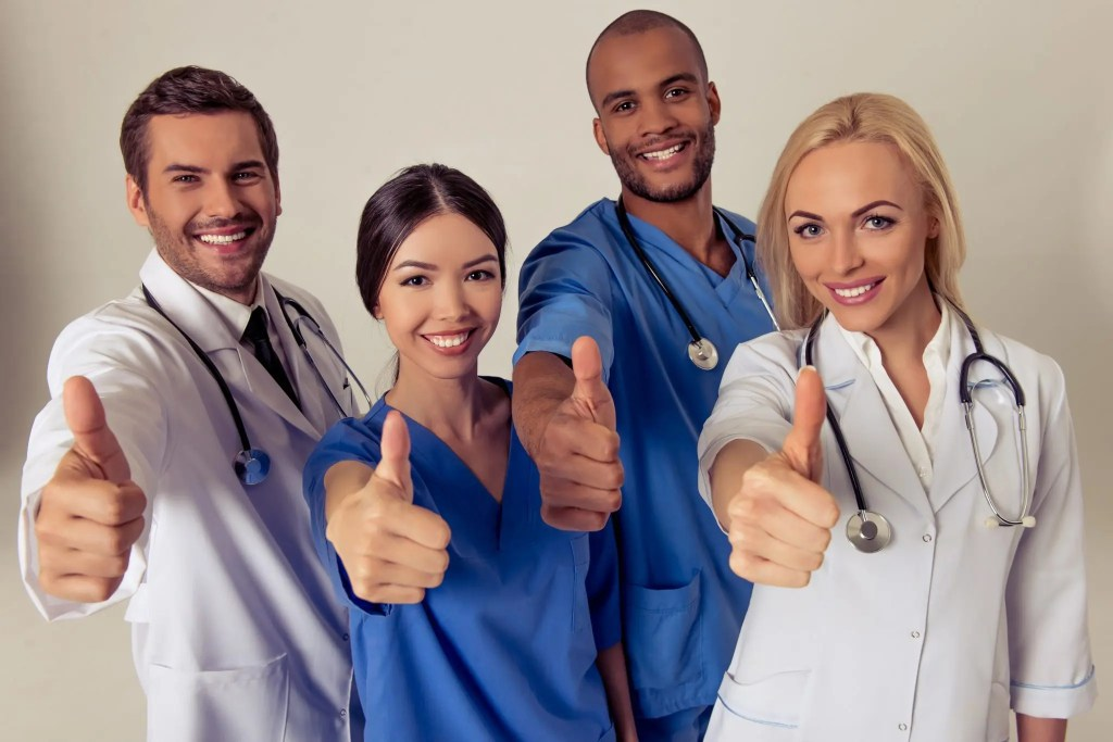 blog picture of doctors smiling with their thumbs up