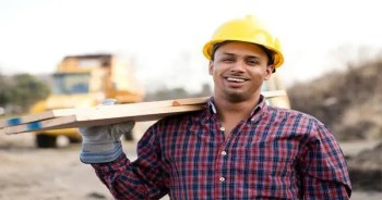 blog picture of construction worker carrying lumber