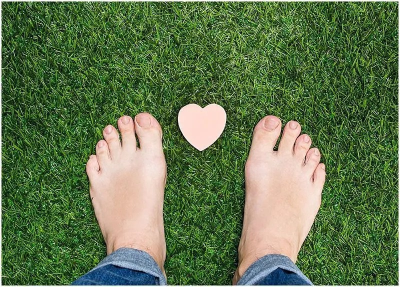 blog picture of feet on grass with a heart in between