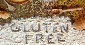 blog picture of various grains and flour with the words gluten free spelled into the flour