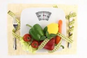 blog picture of weight scale, tape measure and vegetables