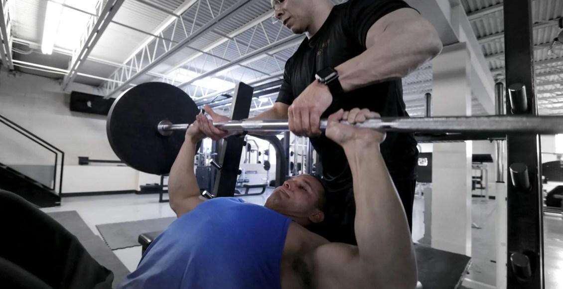 daniel doing bench press & dr. jimenez spots