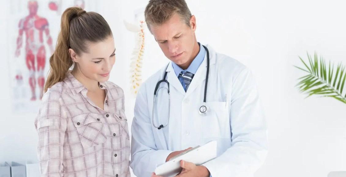 chiropractor shows patient clipboard information