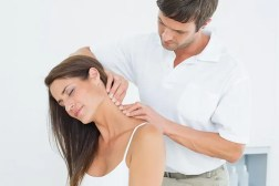 chiropractor works on woman's neck