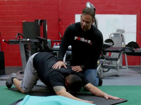 Dr Jimenez helping man stretch_preview