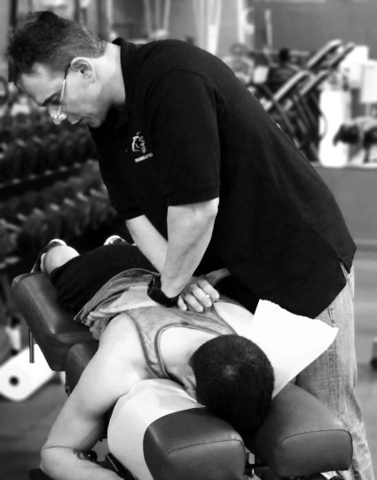 Dr Jimenez works on back treatment at Push crossfit competition_01 BW_preview