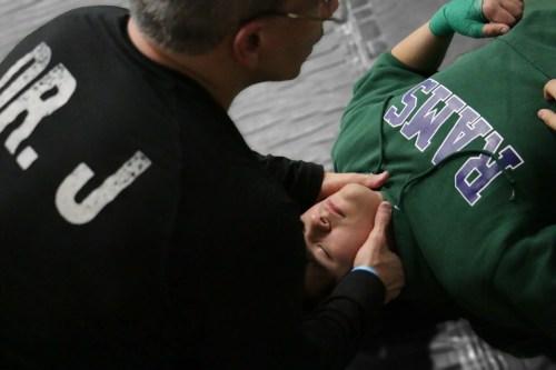 Dr Jimenez works on wrestler's neck_preview   El Paso, TX Chiropractor