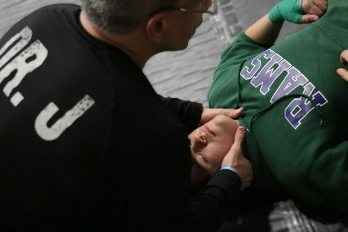 Dr Jimenez works on wrestler's neck_preview | El Paso, TX Chiropractor