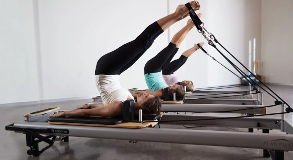 Image of several women participating in Pilates exercises with the use of Pilates equipment. | El Paso, TX Chiropractor