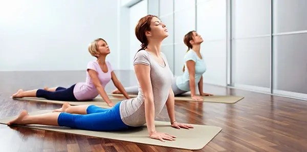 Image of several women engaging in McKenzie method exercises | El Paso, TX Chiropractor
