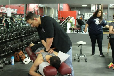 Dr. Alex Jimenez chiropractor treating migraine pain.