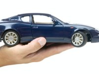 person holding a car showing car insurance