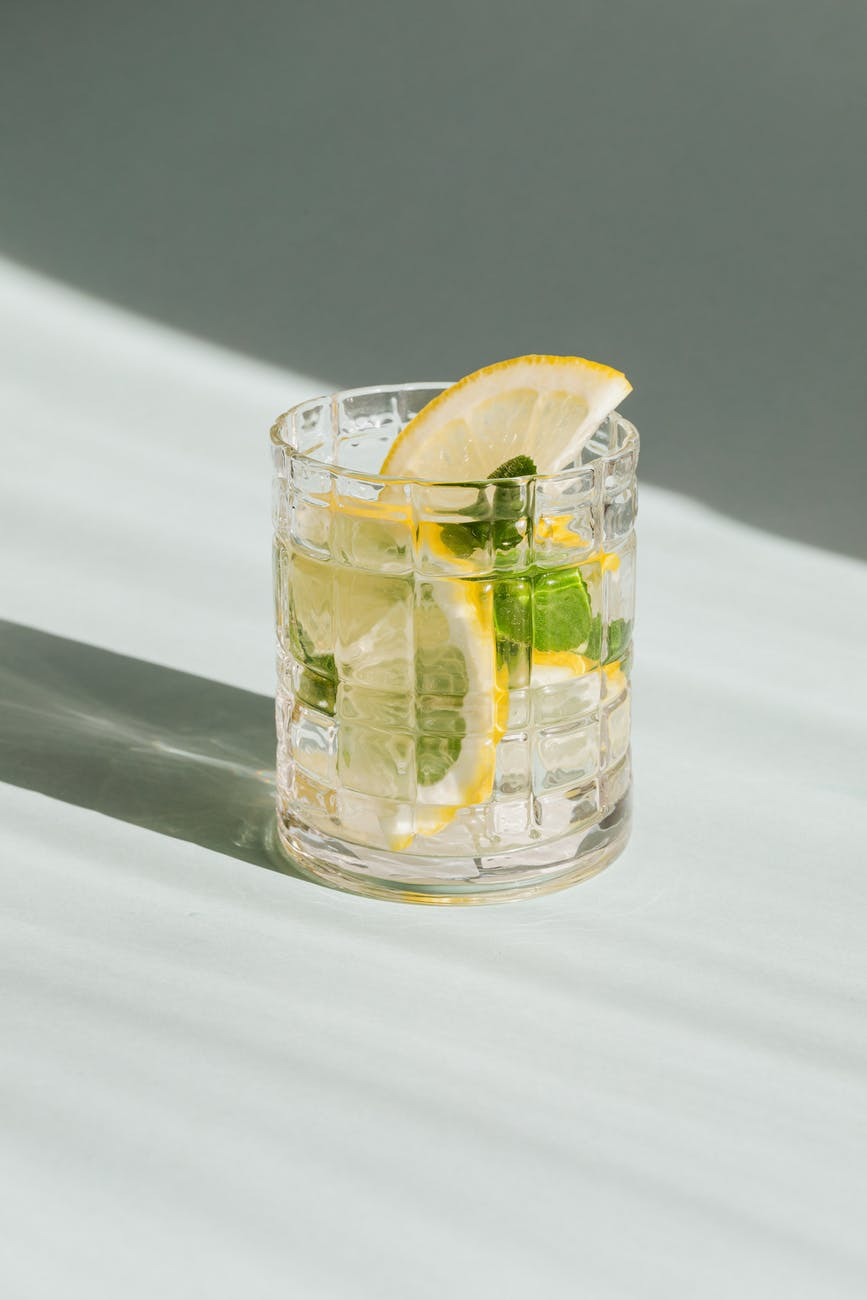 glass of fresh drink on white background