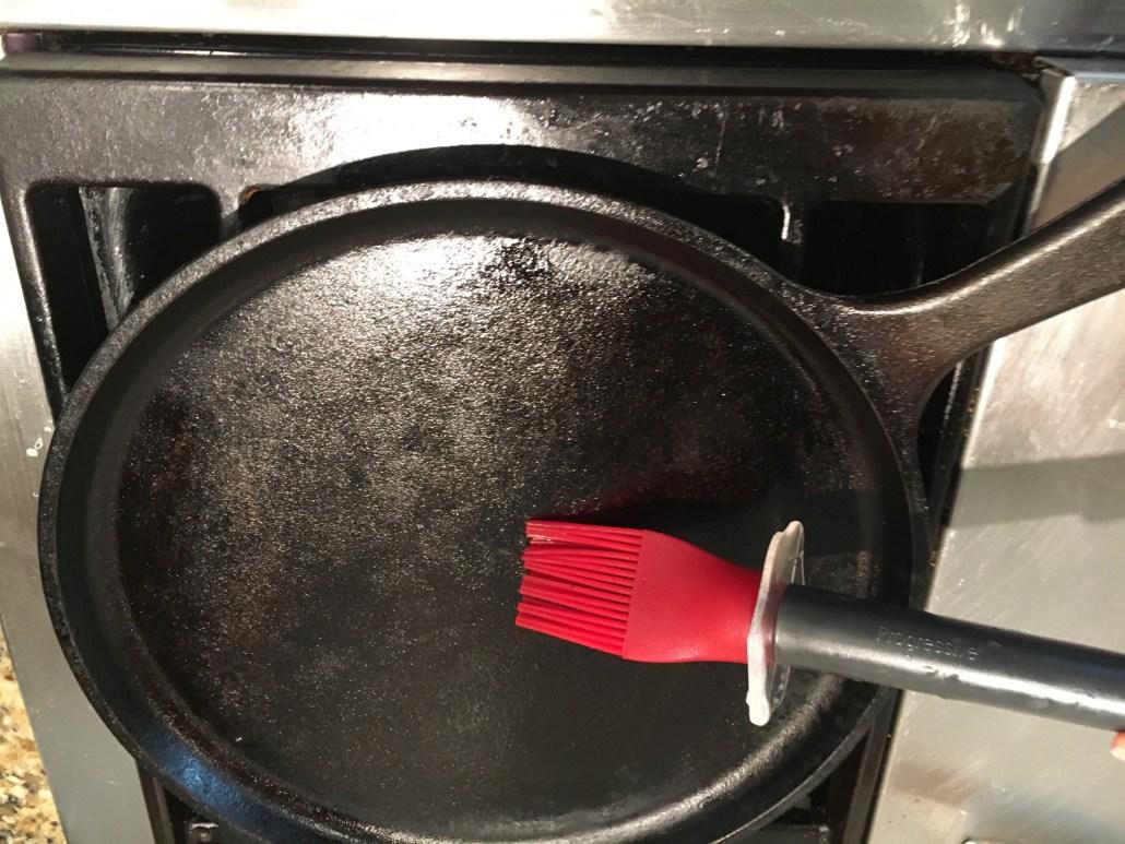 Brushing oil on pan
