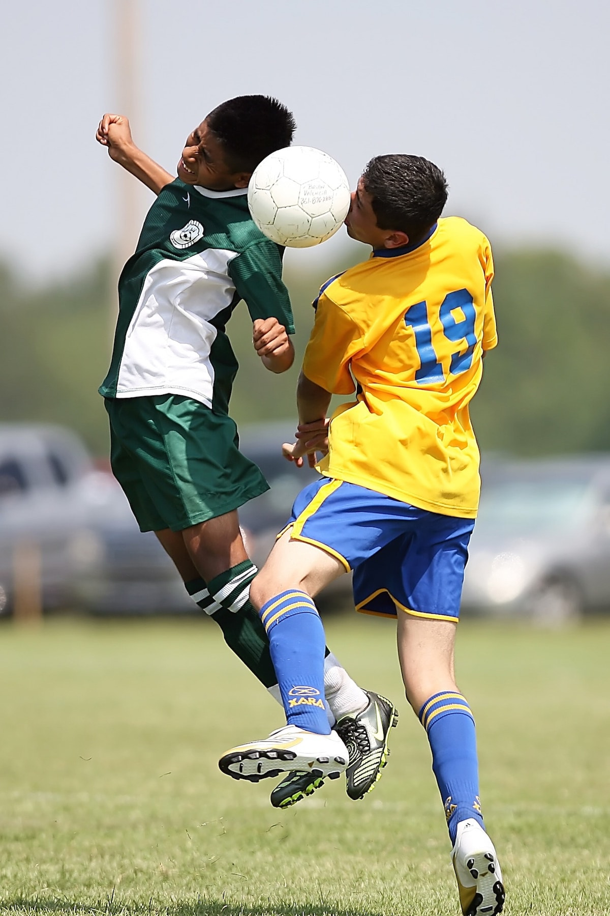 Athletic kids playing soccer, sports related-injuries