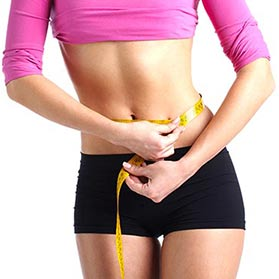 Slender woman-measuring-waist-liposuction