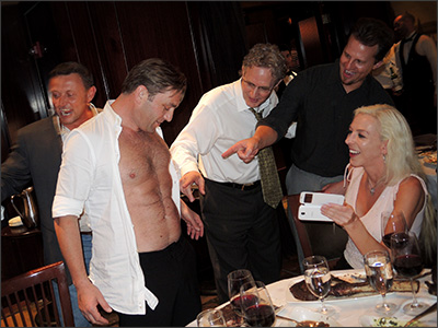 Doctors admiring 6 pack abs created by Liposuction