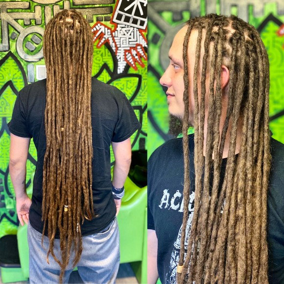 A picture of one of my clients with extra long dreadlocks. Taken after a maintenance appointment. They go down to his mid-thigh.