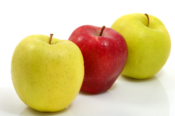 Red and green apples in white background