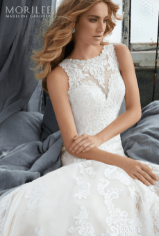 Krista Wedding Dress Romantic Fit and Flare Gown Featuring Frosted, Embroidered Medallions and Appliqués on Net. A Beautiful Illusion Back Trimmed in Covered Buttons Completes the Look. Available in Three Lengths: 55″, 58″, 61″. Shown in Ivory/Crème