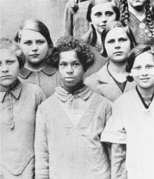African-German girl in a school photo. Pic credit: USHMM