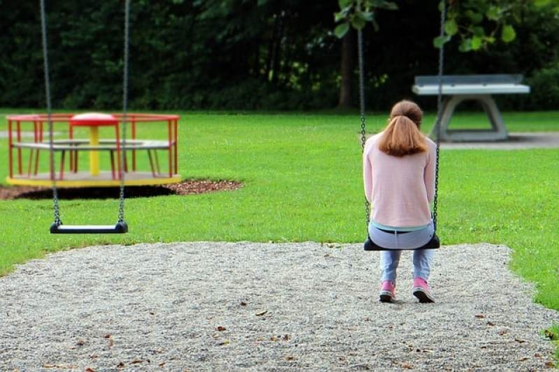 sad woman in a playground