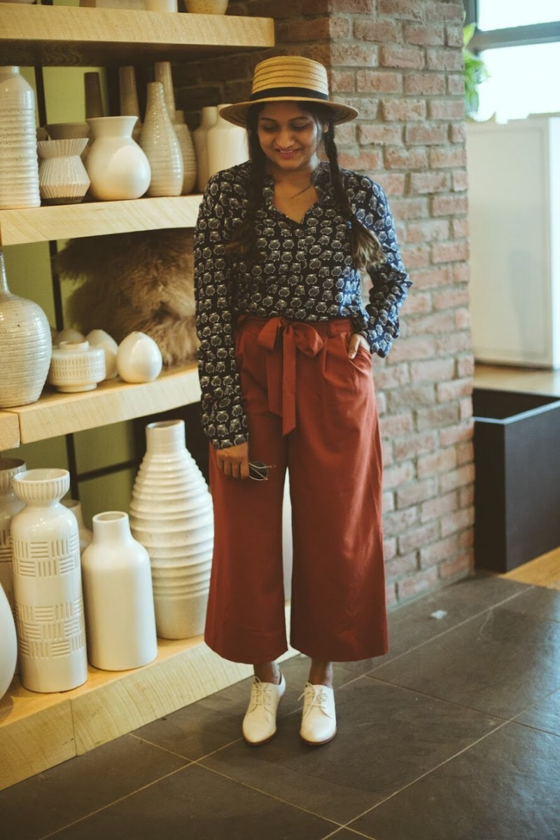 Lifestyle Blogger Surekha of Dreaming Loud Wearing navy and rust vintage fall outfit