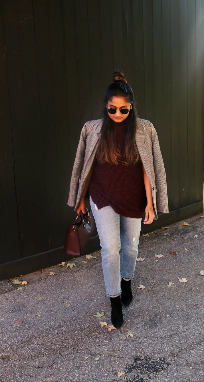 Lifestyle Blogger Surekha of Dreaming Loud wearing tunic sweater with girlfriend jeans and plaid blazer