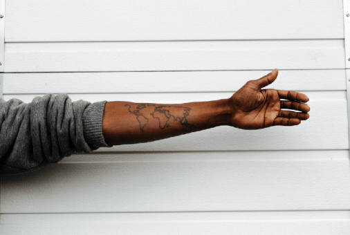 immigrant tattoo world travel economic abroad immigrants
