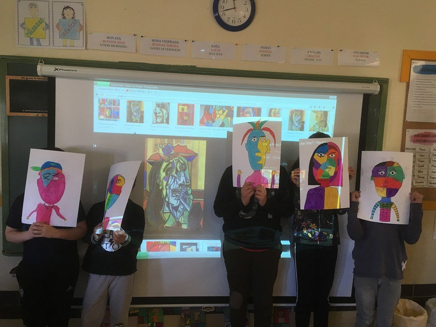 students showing off art