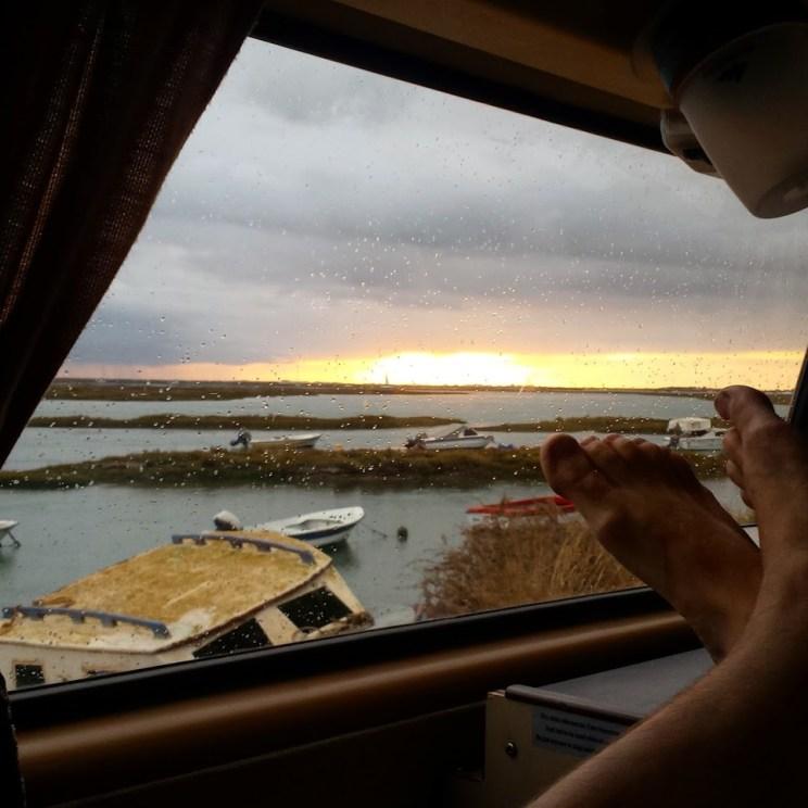Faro sunset rain