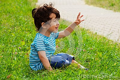 Little Boy Sitting And Waving Stock Photos - Image: 26319343