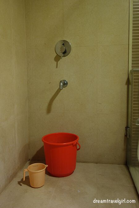 """Shower - there is a """"real"""" shower as well, but I prefer the buckets"""