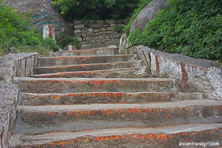 Red and yellow marks on the steps on the way to the temple