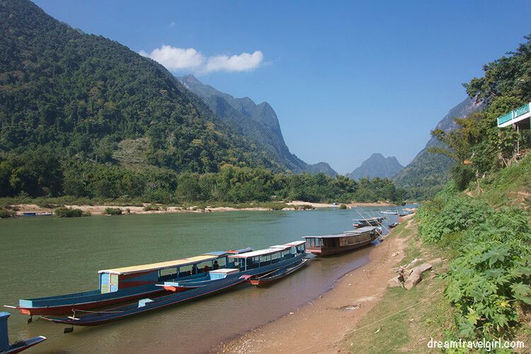 Boats on the Nam Ou river in Muang Ngoi Neua, coming from Nong Khiaw